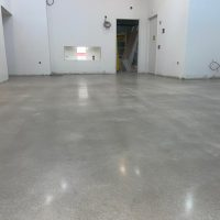 Image depicts a concrete floor in a Wasaga Beach Vape Shop that has been polished by Polished Floors.
