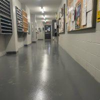 Grey epoxy flooring with anti slip in Toronto factory.
