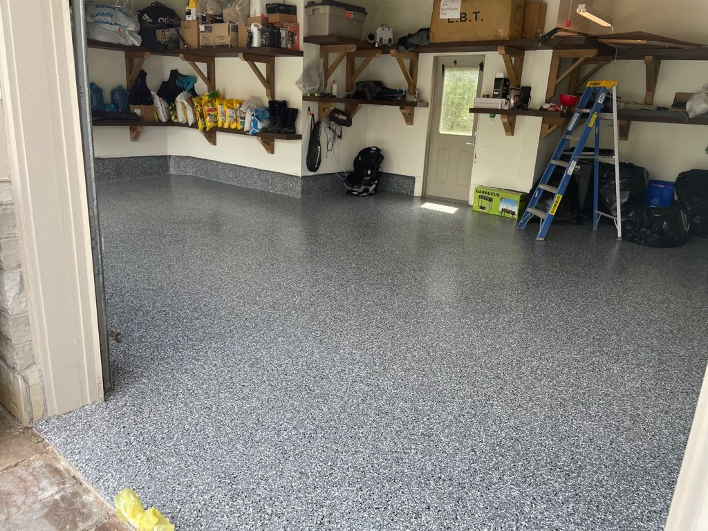 Image depicts a garage from our epoxy 2-car garage Woodbridge project, showing a garage with new epoxy flooring.