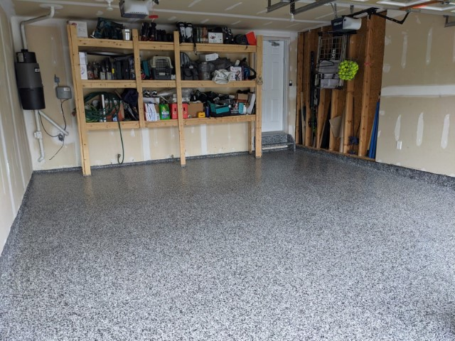 Image depicts a flake epoxy garage floor in a residential garage.