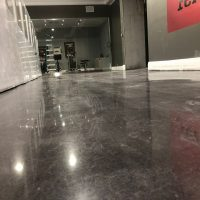 Image depicts a basement floor in a Woodbridge home with black stain and high gloss.