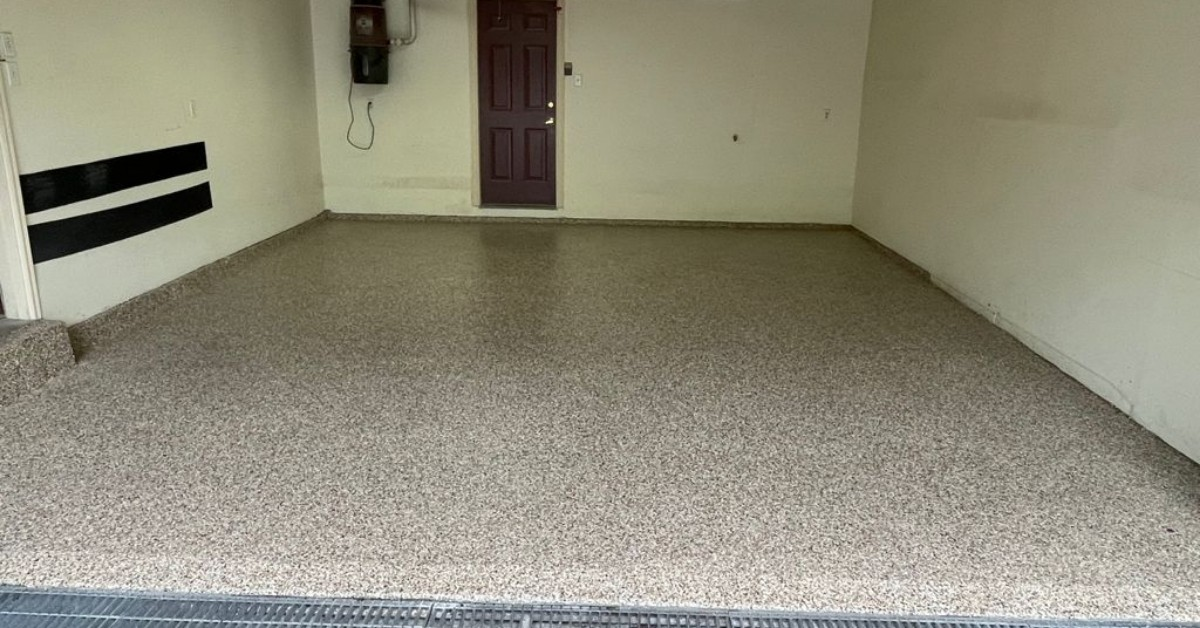 Image depicts a 1-car garage from a recent epoxy garage floors project by Polished Floors