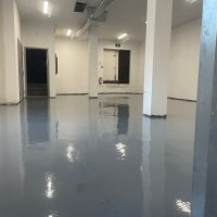Image depicts the interior of a commercial property with commercial grade epoxy floors.