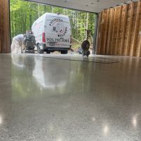 Image depicts a garage in the GTA with polished concrete.