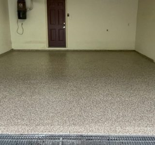 Image depicts a 1-car garage in Toronto with new epoxy floors.